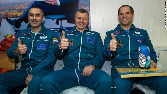 Three return from space station