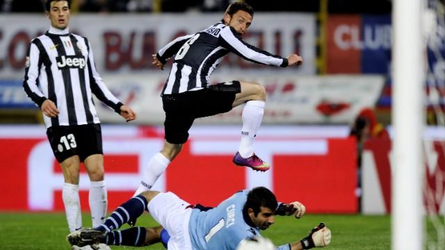Claudio Marchisio scores the second goal as Juventus beat Bologna 2-0 at Stadio Renato Dall'Ara on Saturday.