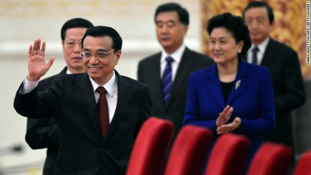 Chinese Premier Li Keqiang arrives for his first news conference Sunday at the Great Hall of the People in Beijing.