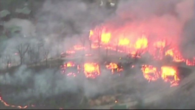 Massive fire threatens dozens of cabins