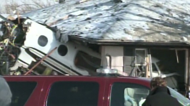 Private jet crashes into neighborhood