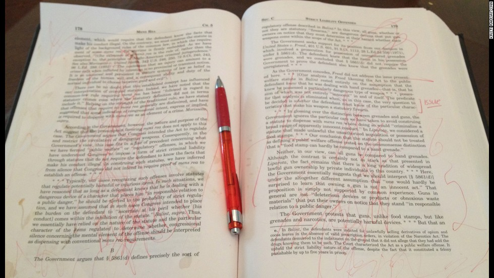 Art time doesn't always go as planned. This piece, circa February 2013, consists of fine red doodles and splashes of coffee, on the canvas of a $200 textbook.