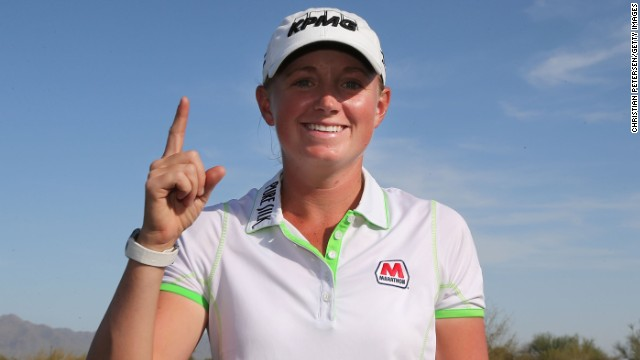 American Stacy Lewis became just the seventh player to top the Rolex World Rankings.