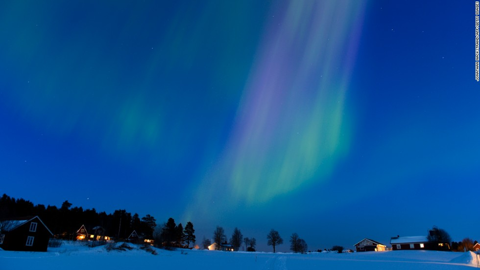 The aurora borealis lights up the sky at twilight on Sunday, March 17, between the towns of Are and Ostersund, Sweden.