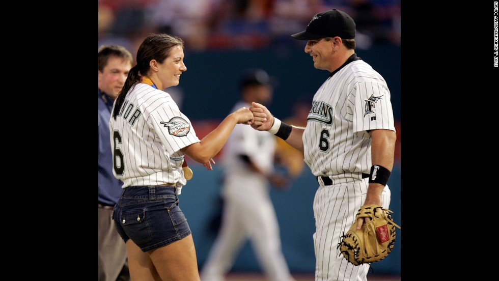 """Misty May, Olympic Gold Medalist in beach volleyball, and Major League baseball player Matt Treanor have been married since 2004. After winning her third gold medal with her volleyball partner Kerri Walsh Jennings in the 2012 London Olympics, she <a href=""""http://www.time.com/time/magazine/article/0,9171,2121056,00.html"""" target=""""_blank"""">announced</a> she was retiring to start a family. Pictured, Misty May knocks fists with her fiance at the time after throwing the first pitch before the start of the Florida Marlins against the Atlanta Braves in Miami, September 2004."""