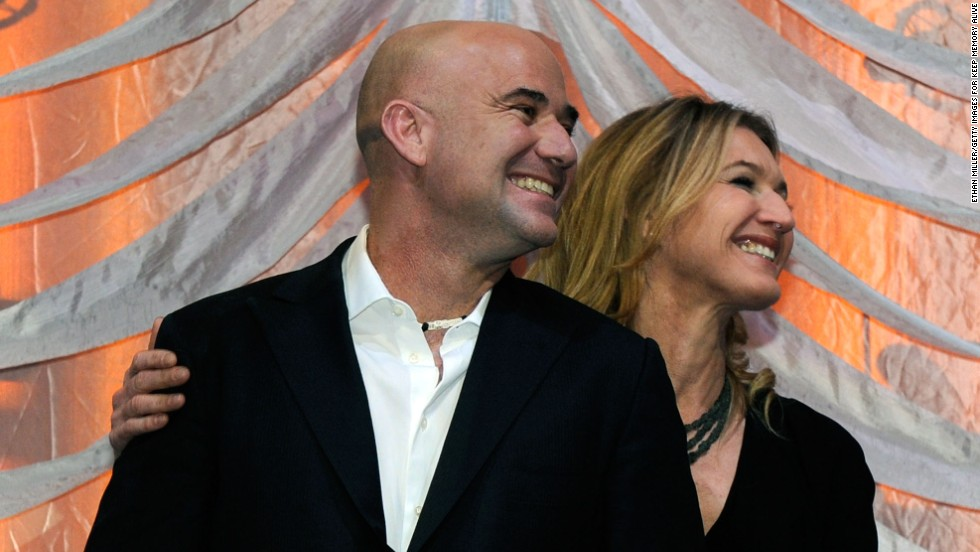 Pro tennis players Andre Agassi and Steffi Graf have 30 grand slam singles titles between them, and they still play together in doubles exhibition matches. They married in 2001. Pictured, the couple smiles from onstage during a nonprofit event, February 2012.