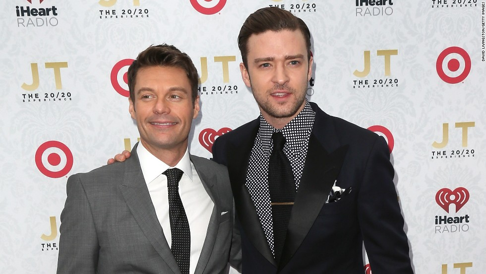 "Ryan Seacrest poses with Timberlake at the iHeartRadio ""20/20"" album release party on March 18 in Los Angeles."