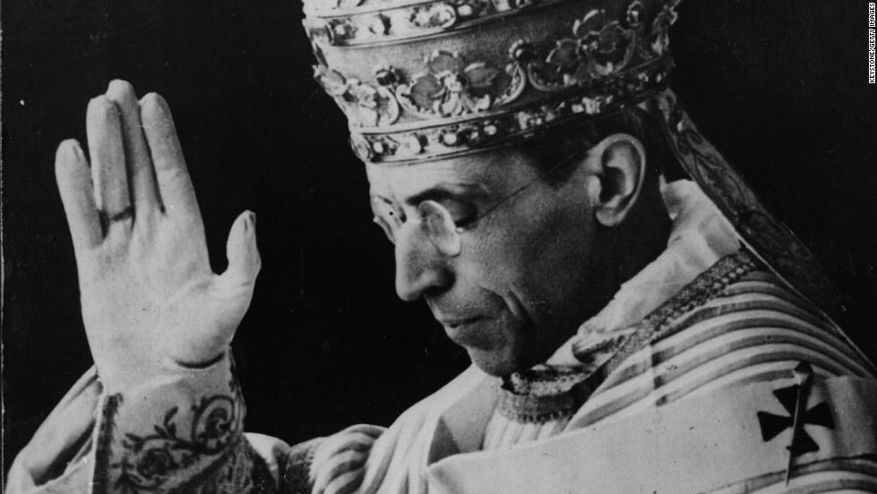 "Pictured here in December 1939, Pope Pius XII, wearing the triregnum, bestows a blessing during a visit to the king and queen of Italy. The triregnum is the three-tiered papal tiara, or triple crown, that was placed on the head of the pope during the ""coronation"" part of the inaugural mass, Beck said. ""It was last worn by Pope Paul VI, who seemed to think better of it because during the Second Vatican Council, he dramatically put it on the altar at St. Peter's Basilica and said to sell it and give the money to the poor,"" Beck said.  No pope has had a coronation or worn the triregnum since."