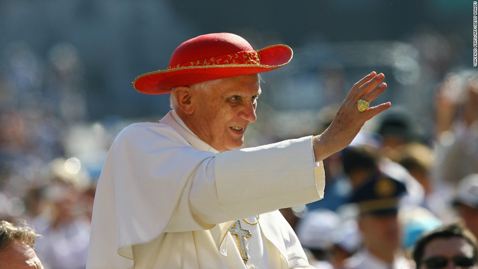 "Pope Benedict XVI, seen here wearing a saturno, blesses the faithful in St. Peter's Square at the Vatican, in 2006. The saturno is a wide-brimmed red hat that gets its name from its resemblance to the planet Saturn and its rings, Beck said. ""It has been used as the summer alternative to the winter camauro, "" he said, but unlike the winter hat, it's not not unique to the pope."