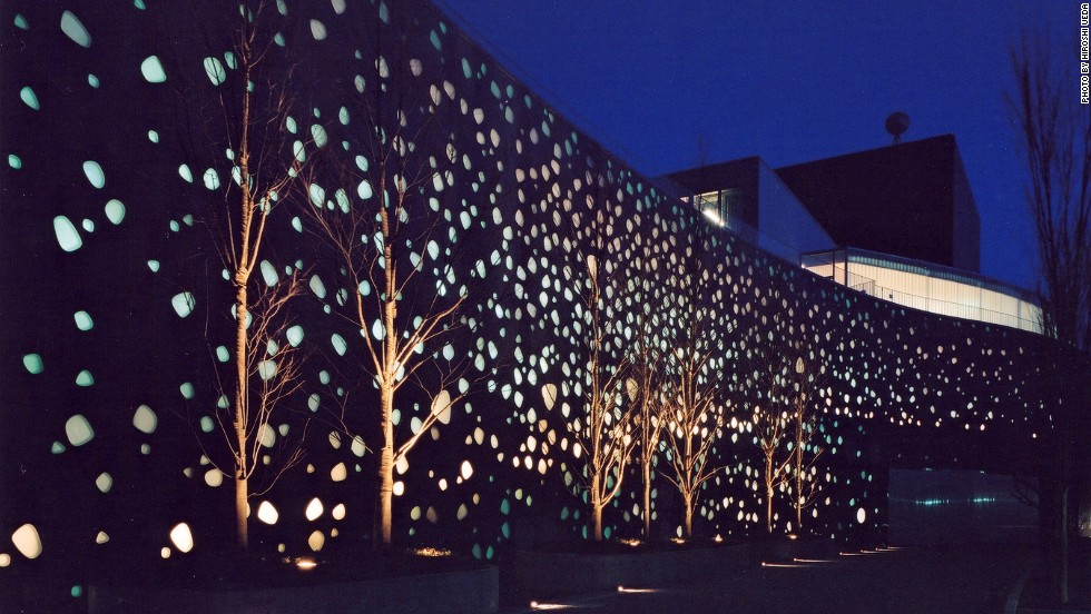"The design for the arts center uses glass-inlaid panels for lighting that's ""responsive to a variety of sequences"" for a ""random and natural"" effect instead of a geometric one."