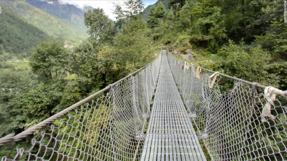 Mudslide Bridge crosses a chasm along the trekking route from Lukla to Namche Bazaar near Mount Everest in Nepal. It's been wiped out by mudslides several times.