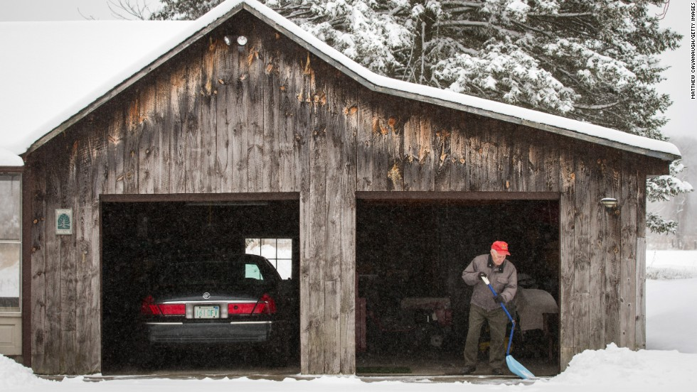 World War II veteran Sam Melnik, 90, shovels snow from his driveway on Tuesday, March 19, in Deerfield, Massachusetts.