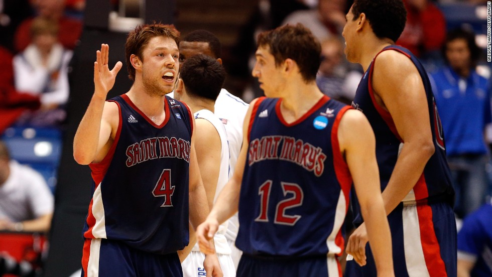 Matthew Dellavedova, left, of the St. Mary's Gaels celebrates with teammates during the First Four round of the NCAA tournament on Tuesday, March 19, in Dayton, Ohio. St. Mary's defeated Middle Tennessee 67-54 and will take on Memphis on March 21.
