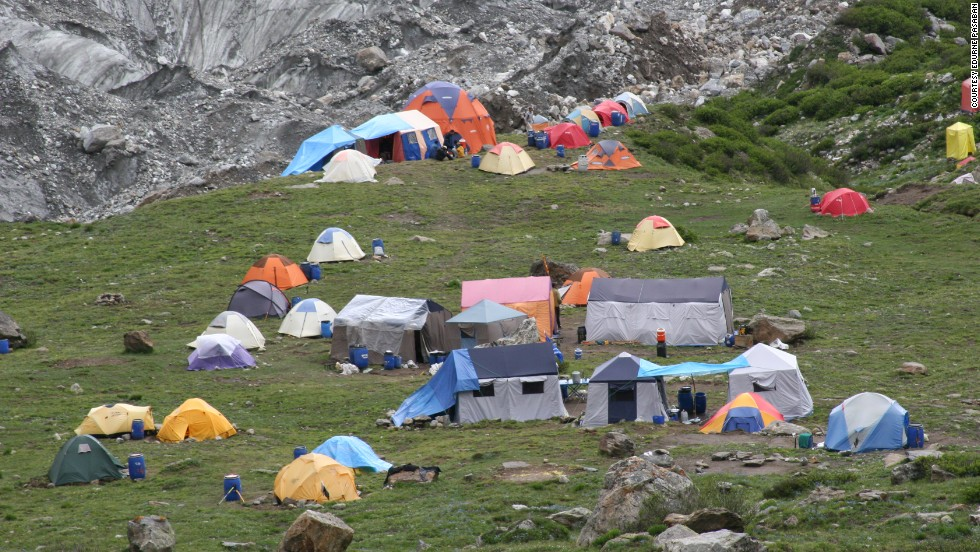 An image of a base camp at Nanga Parbat in 2005 shows the scale of a planned ascent. National Geographic named Pasaban its Adventurer of the Year in 2011 after she completed her challenge.