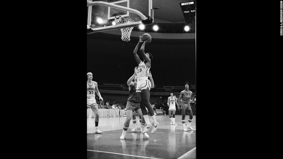 President Barack Obama shoots during a basketball game for Punahou High School in Hawaii in 1979. Obama played guard for the team and continues to play on a court he had installed at the White House. A invitation to play in one of the president's games is a hot commodity in D.C.