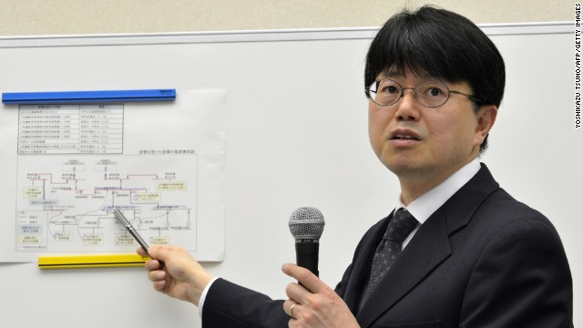 Masayuki Ono (2nd L), acting head of Tokyo Electric Power Co (TEPCO) nuclear power and facilities section speaks at a news conference at the company's headquarters in Tokyo on March 19, 2013.