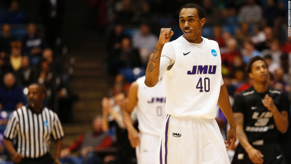 Devon Moore of James Madison celebrates in the first half against LIU Brooklyn on March 20.