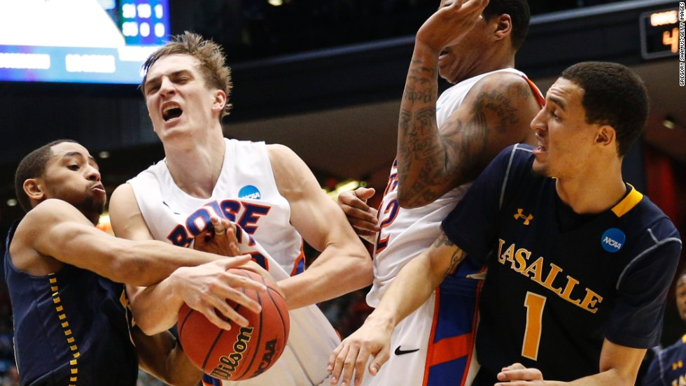 Anthony Drmic of Boise State fights for possession with Tyreek Duren, left, and D.J. Peterson, right, of La Salle on March 20.