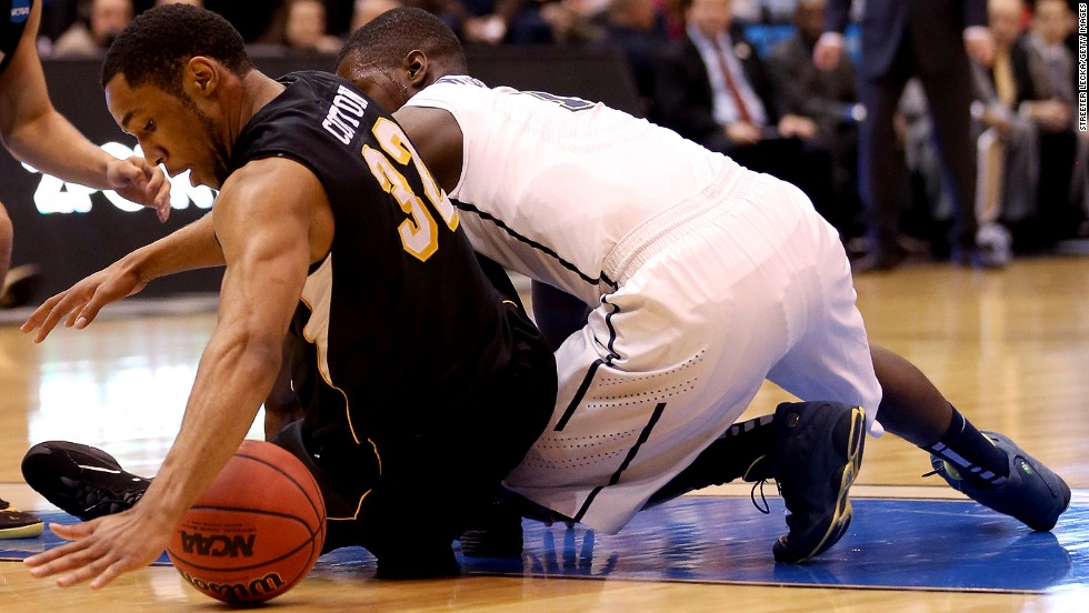 Tekele Cotton of Wichita State, left, tries to recover the ball as Tray Woodall of Pittsburgh goes after it on March 21.