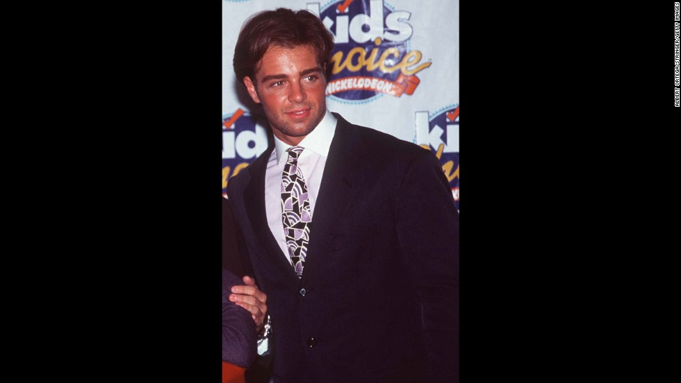 "With his puppy dog eyes and luscious hair, Joey Lawrence was a constant presence in teen magazines in the '90s -- frequently in sleeveless shirts or vests. On the sitcom ""Blossom,"" he played the clueless but adorable older brother of Mayim Bialik's titular character, turning ""Whoa!"" into a catchphrase."