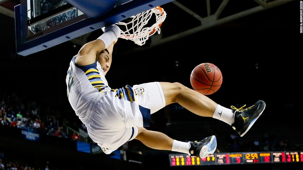 Trent Lockett of Marquette slam dunks against Davidson on March 21.