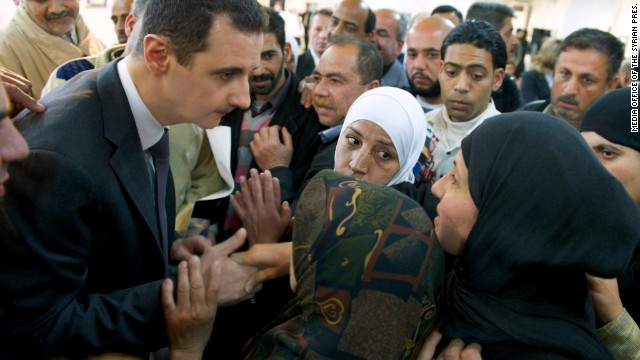 "Syrian President Bashar al-Assad makes a ""surprise"" visit to an educational center in Damascus on Wednesday, March 20, 2013."