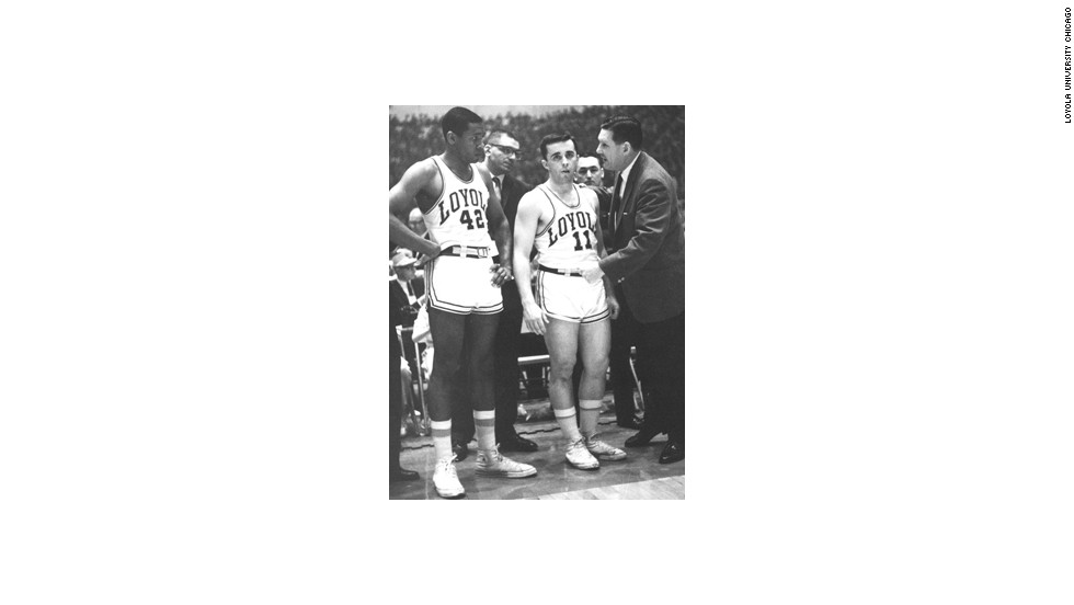 Loyola coach George Ireland (right) had four black players in his starting lineup during an era when college basketball was still predominantly white.