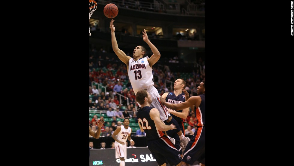Nick Johnson of Arizona takes a shot as he jumps into Reece Chamberlain of Belmont on March 21.