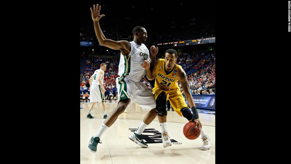 Laurence Bowers of Missouri drives against Greg Smith of Colorado State on March 21.