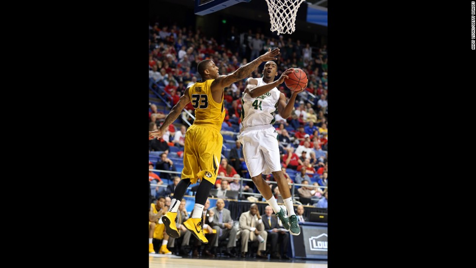 Greg Smith of Colorado State goes up for a shot against Earnest Ross of Missouri on March 21.