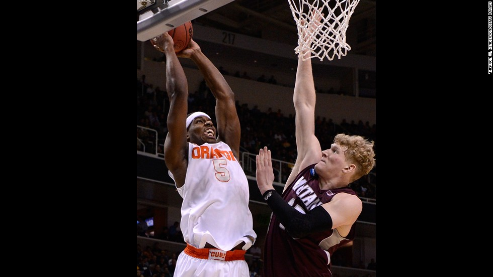 C.J. Fair of the Syracuse Orange drives to the basket against Eric Hutchison of the Montana Grizzlies on March 21.