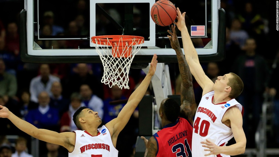 Ryan Evans, left, and Jared Berggren of the Wisconsin Badgers block a shot by Murphy Holloway, center, of the Ole Miss Rebels on March 22.