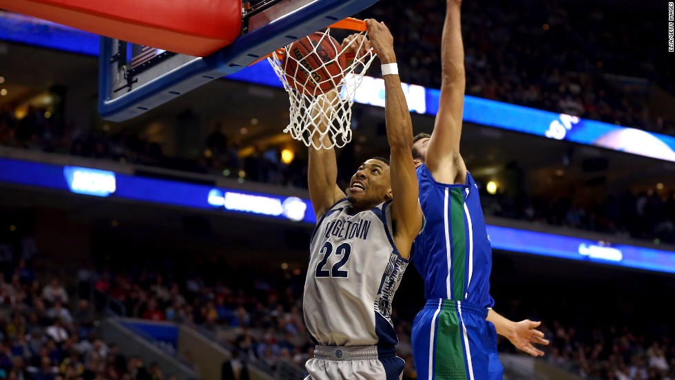 Otto Porter of the Georgetown Hoyas, left, dunks against Chase Fieler of the Florida Gulf Coast Eagles on March 22.