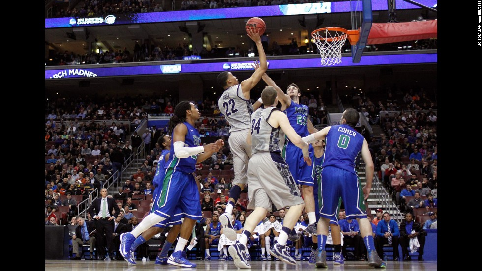 Otto Porter Jr. of the Georgetown Hoyas, center, attempts a shot against Eddie Murray, center right, of the Florida Gulf Coast Eagles on March 22.