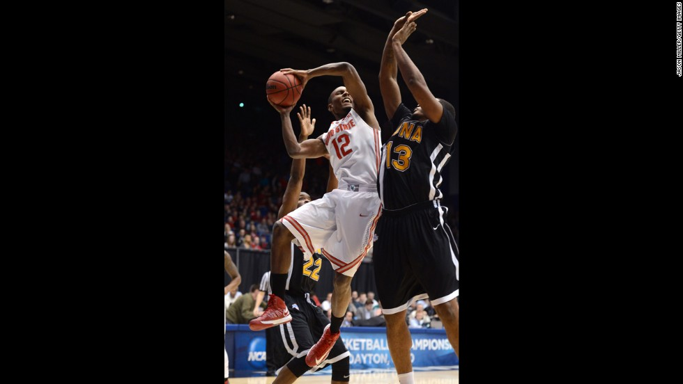 Sam Thompson of the Ohio State Buckeyes, left, drives to the basket against David Laury of the Iona Gaels on March 22.