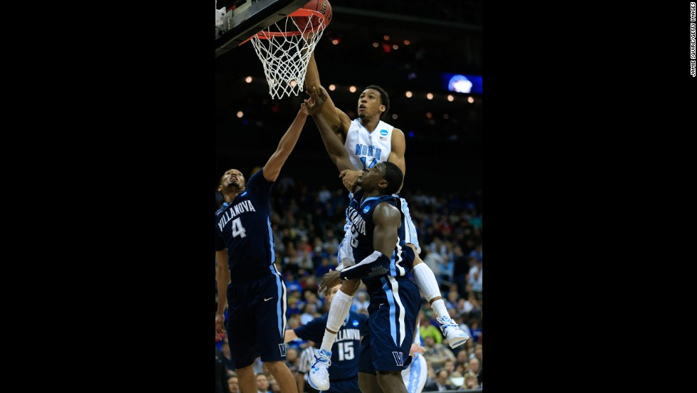 Desmond Hubert of the North Carolina Tar Heels, top, shoots against Darrun Hilliard, left, and Mouphtaou Yarou of the Villanova Wildcats on March 22.