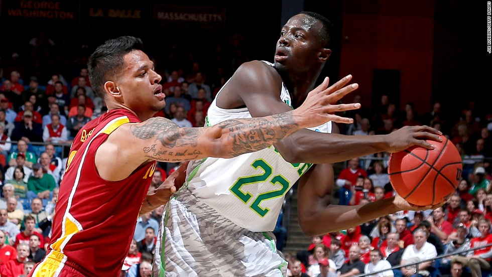 Jerian Grant of the Notre Dame Fighting Irish, right, looks to pass against Chris Babb of the Iowa State Cyclones on March 22.