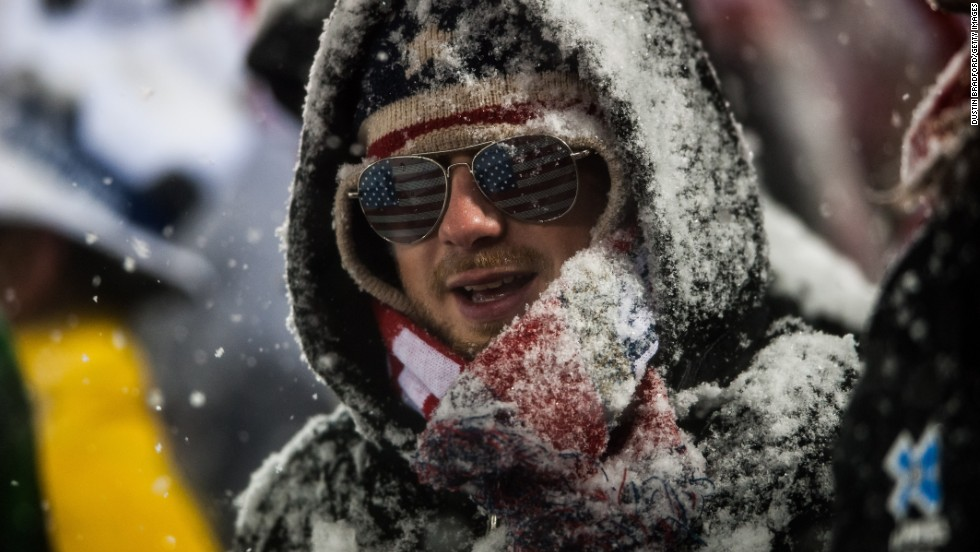A fan of the United States national team shows his team spirit in the stands, despite being covered in snow on March 22.