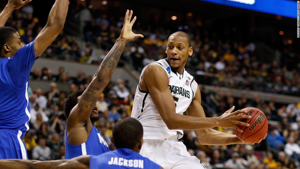 Adreian Payne of the Michigan State Spartans, right, looks to pass as he drives against the Memphis Tigers on March 23 in Auburn Hills, Michigan. The Spartans won 70-48.