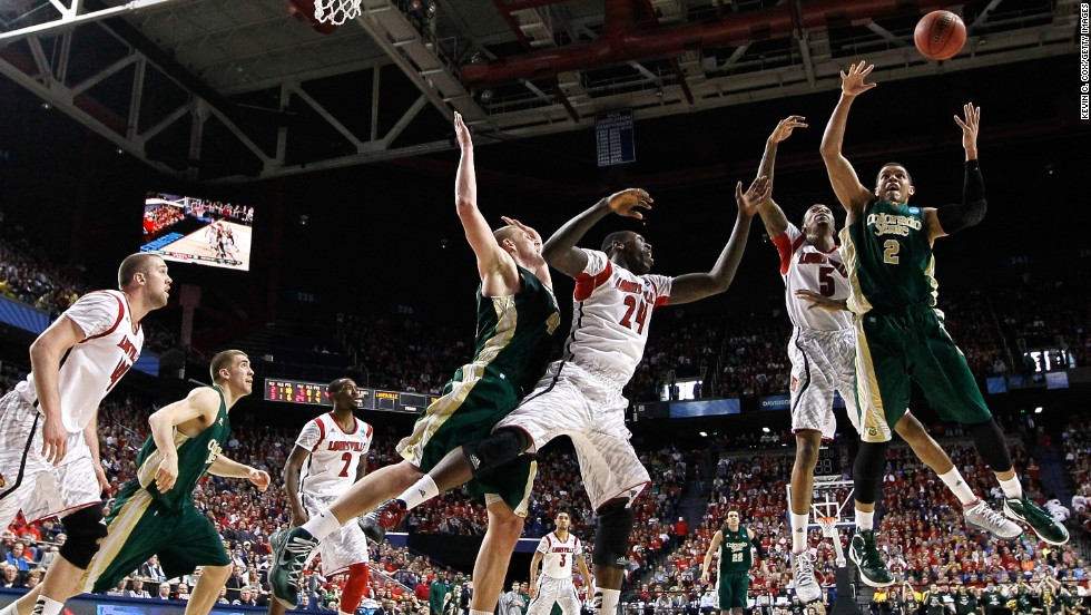 Daniel Bejarano of the Colorado State Rams, right, and Kevin Ware, second from right, of the Louisville Cardinals go up for a rebound on March 23 in Lexington, Kentucky. The Cardinals won 82-56.