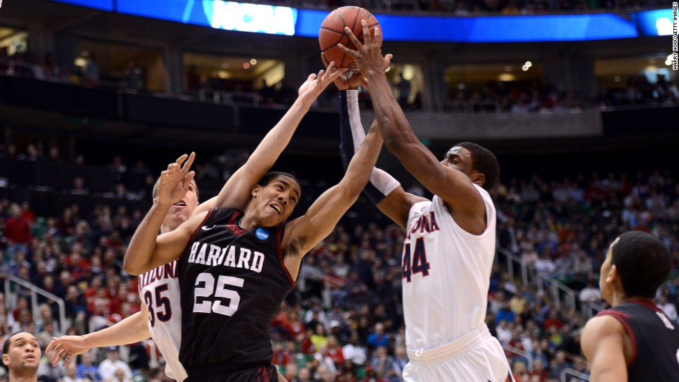 Kaleb Tarczewski, left, and Solomon Hill, right, of the Arizona Wildcats go after a loose ball against Kenyatta Smith of the Harvard Crimson on March 23 in Salt Lake City. The Wildcats won 74-51.