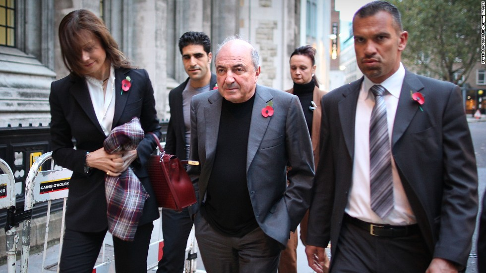 Berezovsky leaves the High Court in London with his partner Yelena Gorbunova, left, in 2011.