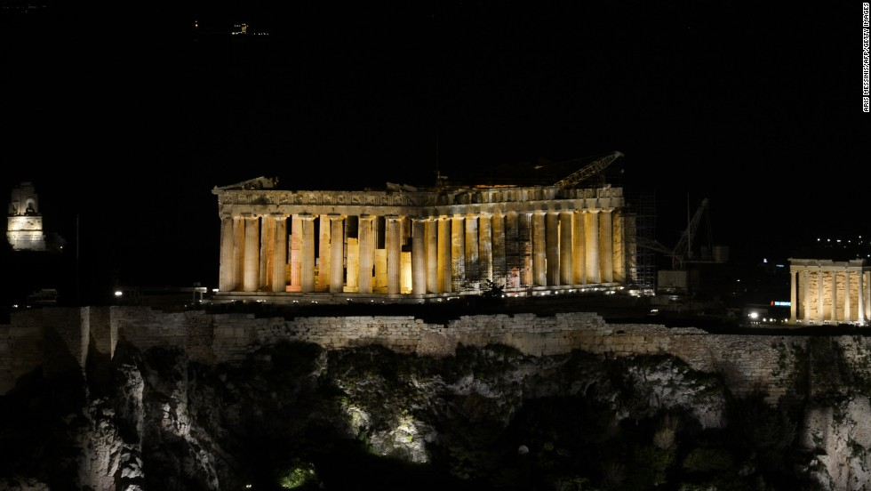 The ancient Temple of Parthenon atop the Acropolis hill before Earth Hour in Athens.