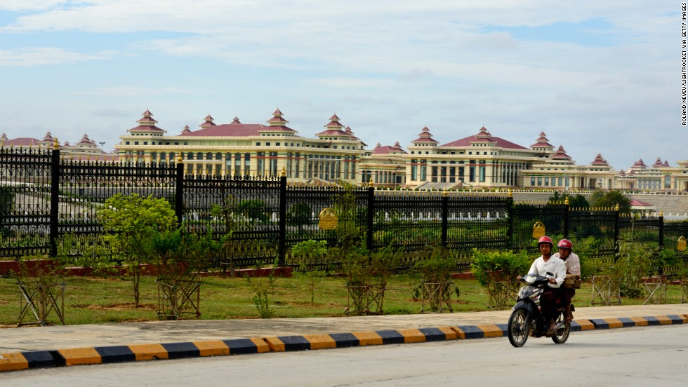A motorbike passes the Assembly of the Union, where the country's upper and lower houses of representatives meet, in Naypyidaw. It is locally called Pyidaungsu Hluttaw.