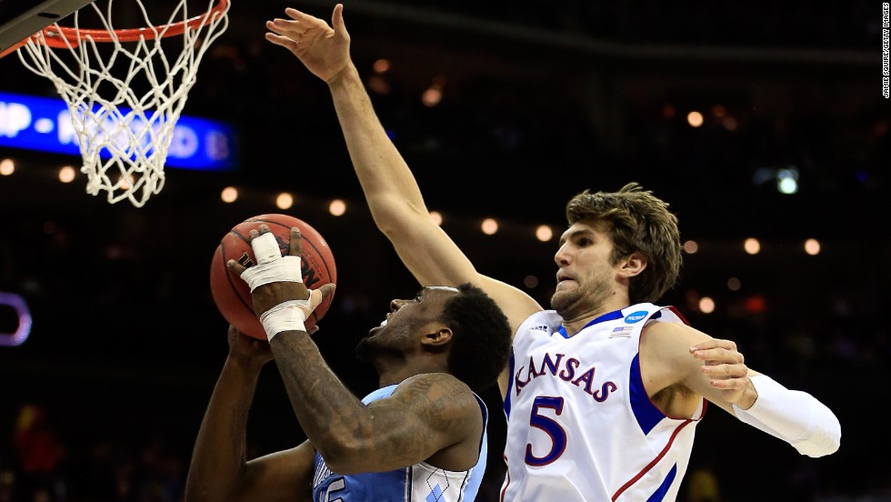 P.J. Hairston of the North Carolina Tar Heels drives for a shot attempt against Jeff Withey of the Kansas Jayhawks on March 24 in Kansas City, Missouri. Kansas defeated UNC 70-58.
