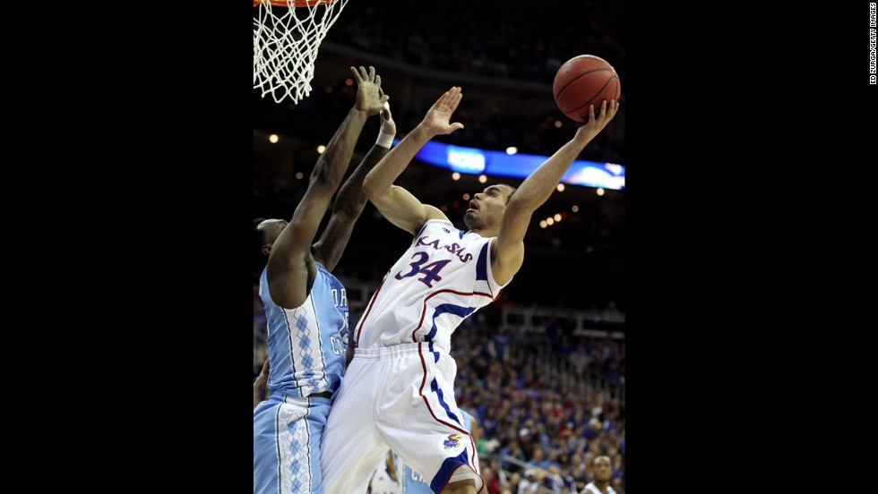 Perry Ellis of Kansas attempts a shot on March 24.