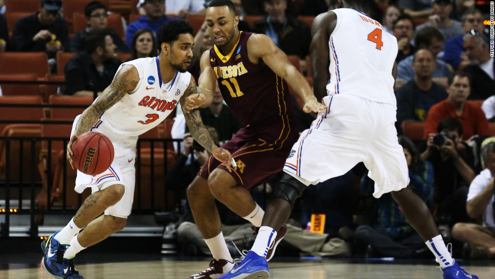 Mike Rosario of Florida, left, drives against Joe Coleman of Minnesota on March 24 in Austin, Texas. Florida defeated Minnesota 78-64.