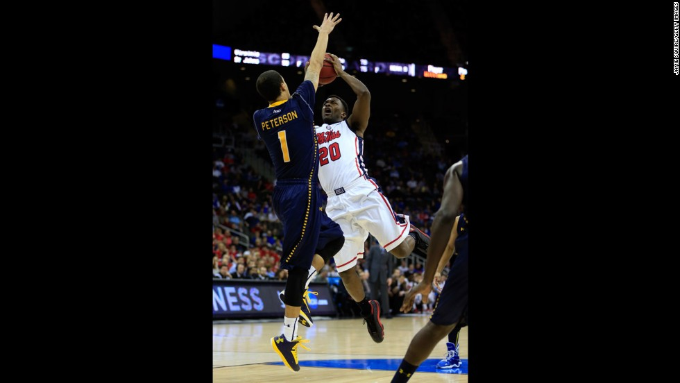 Nick Williams of Ole Miss attempts a shot against D.J. Peterson of La Salle on March 24.