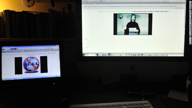 Monitors display the hacked Greek ministry of justice website on February 3, 2012.