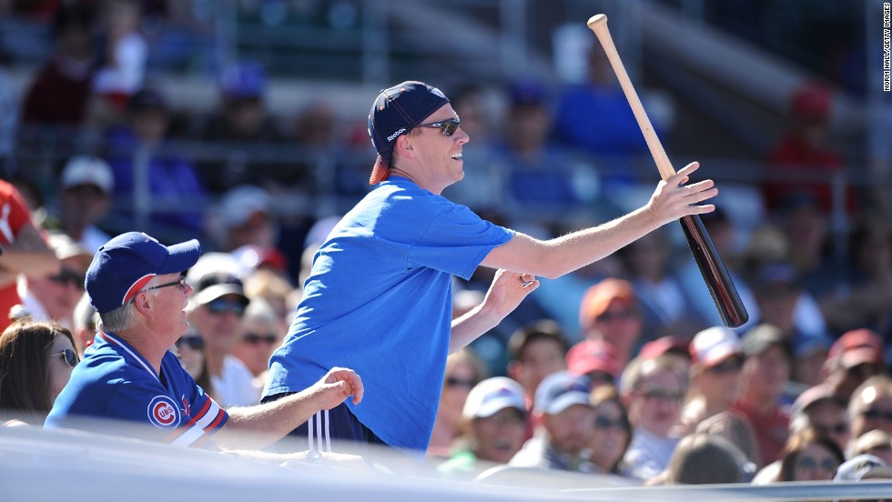 A Cubs fan catches a bat in the stands during a game against the Arizona Diamondbacks on March 1.